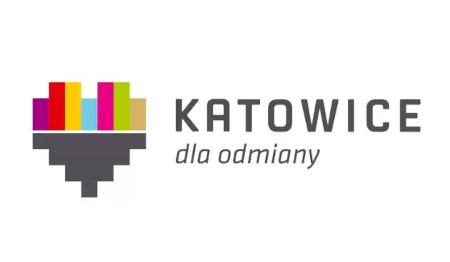 logo Katowic w kszałcie serca, kolor dominujący - czarny, po prawej stronie napis Katowice dla odmiany
