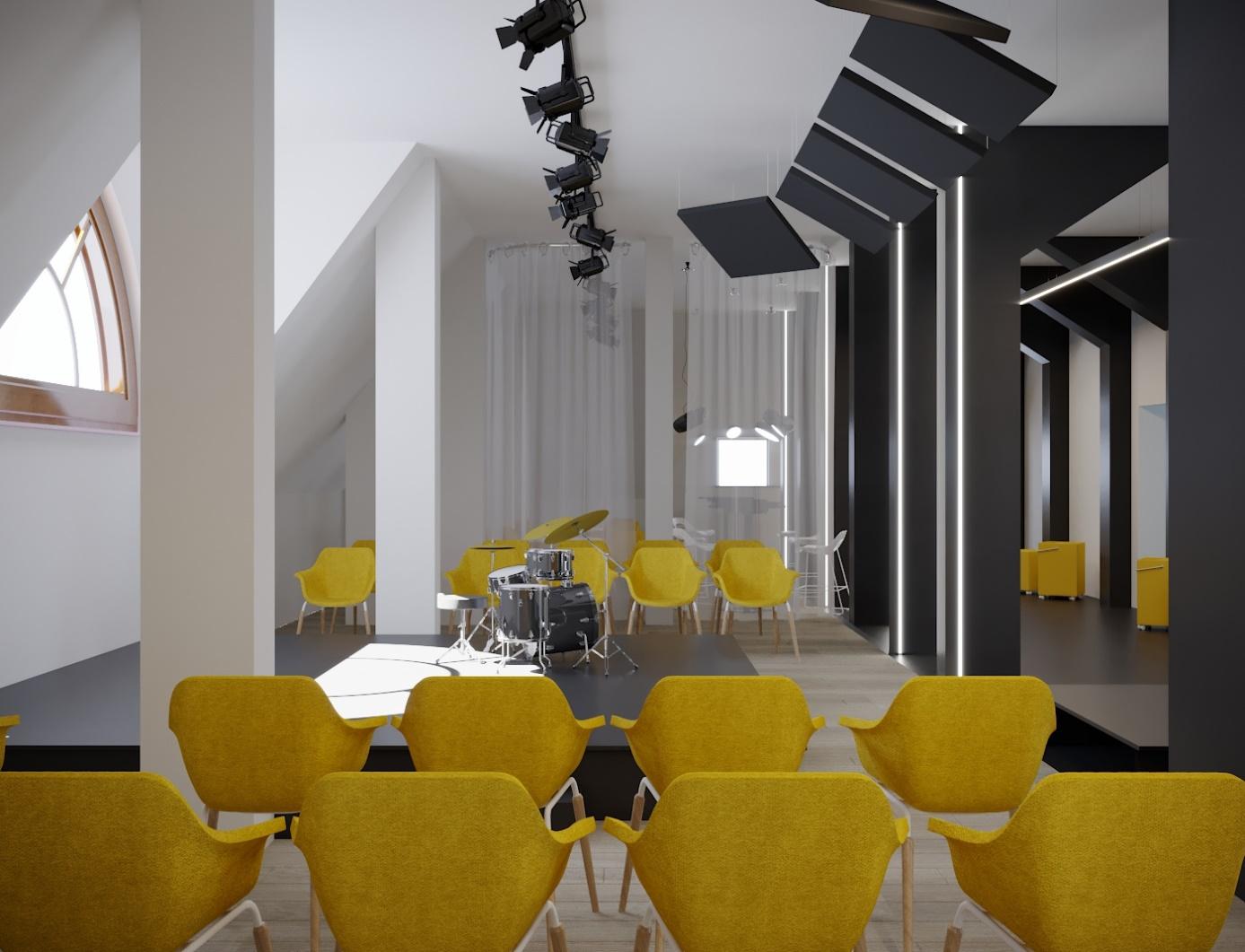 Sala ze sceną i krzesłami