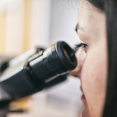 A girl and a microscope